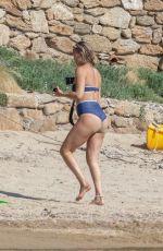 KATE HUDSON in Bikini at a Beach in Skiathos 06/19/2021