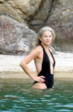 KATE HUDSON in Swimsuit at a Beach in Greece 06/13/2021