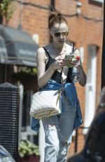 PHOEBE DYNEVOR in Ripped Denim Out in London 05/31/2021