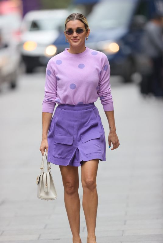 ASHLEY ROBERTS in a Purple Mini Skirt and Polka Dot Top at Heart Radio in London 07/13/2021