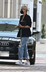 CHARLIZE THERON in Ripped Denim Out Shopping in Beverly Hills 07/16/2021