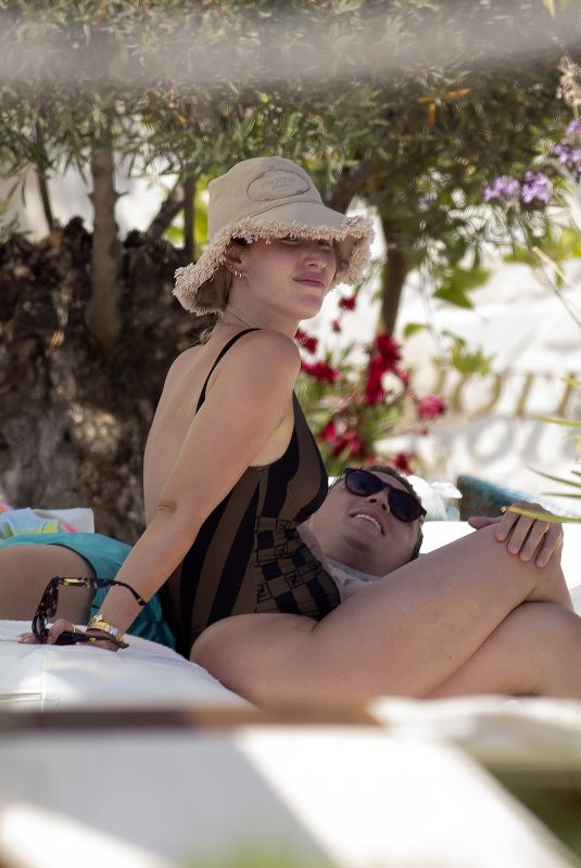 CHARLOTTE TRIPPIER in Swimsuit at a Pool in Ibiza 07/20/2021