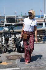 KAROLINA KURKOVA Arrives in Capri at UNICEF Italia and LuisaViaRoma Summer Gala 07/30/2021