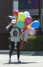 KATE MARA Picks up Balloons to Celebrate Her Stepson