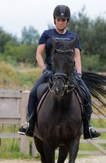 KATIE PRICE Riding a Horse at Her Stables in Essex 07/22/2021