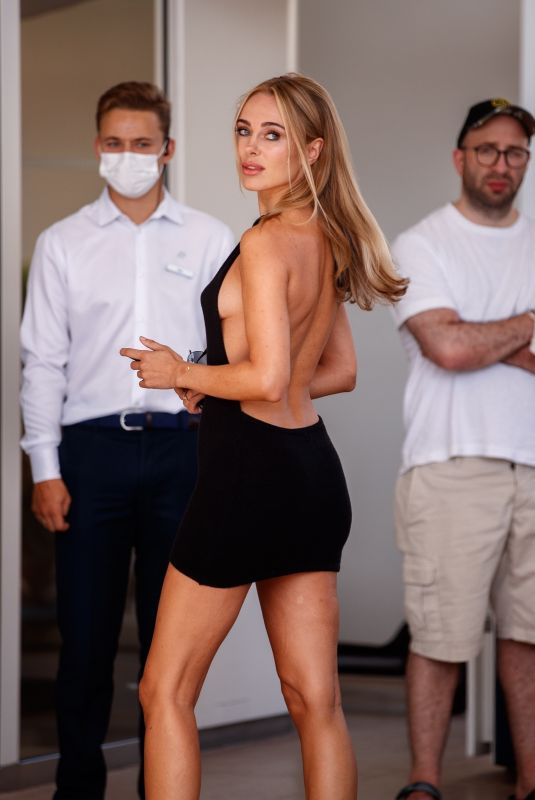 KIMBERLEY GARNER in a Black Backless Minidress at Martinez Hotel in Cannes 07/15/2021