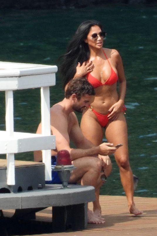 NICOLE SCHERZINGER in a Red Bikini Celebrates Her 43rd Birthday in Lake Como 06/28/2021