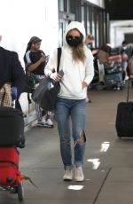 OLIVIA WILDE in Ripped Denim at LAX Airport in Los Angeles 07/19/2021