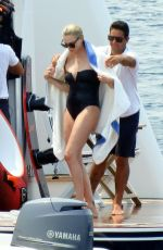 CHARLIZE THERON in a Black Swimsuit at a Yacht in Greece 08/08/2021