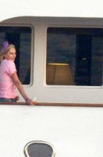 CHARLIZE THERON Poseing at a Yacht on Her 46th Birthday in Mykonos 08/07/2021