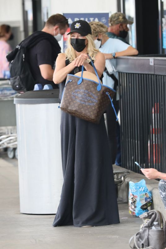 HEATHER LOCKLEAR at LAX Airport in Los Angeles 08/22/2021