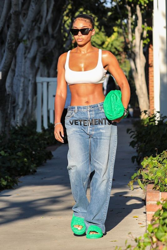 LORI HARVEY in a Sports Bra and Denim Shopping on Melrose Place in West Hollywood 08/25/2021