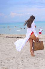 TAO WICKRATH in a Red Bikini at a Beach in Miami 08/02/2021