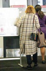 ELIZABETH OLSEN at LAX Airport in Los Angeles 09/20/2021
