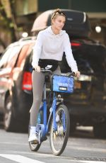 KATE BOCK Rides a Citi Bike Out in New York 09/20/2021