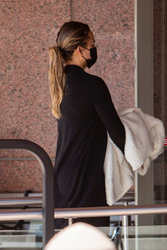 CHRISSY TEIGEN Arrives at an Office Building in Beverly Hills 09/30/2021