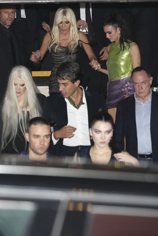 DUA LIPA and DONATELLA VERSACE Arrives at Versace x Frieze Event at Toklas Restaurant in London 10/15/2021
