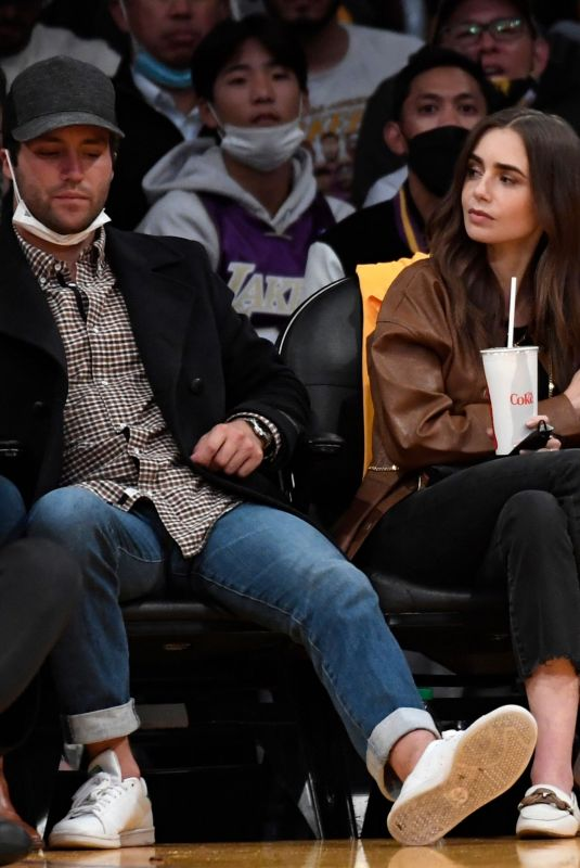 LILY COLLINS at Golden State Warriors vs. LA Lakers Game at Staples Center 10/19/2021